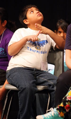 Marana Unified School District Spelling Bee: Thornydale Elementary student Isaac Castillo recounts the spelling of a word after sitting down during the Marana Unified School District's spelling bee last week.  - Randy Metcalf/The Explorer