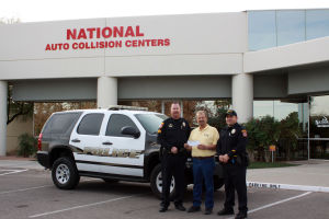 CDO High School Puts Local Spin On National Safe Driving Program: OVPD officers Steve Hammons, left, and Ron Beauchamp, right, accept a check from National Auto Collision Centers owner Bill Jones for a safe driving program. - Courtesy Photo