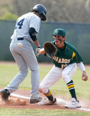 Canyon Del Oro Vs Ironwood Ridge Baseball: Ironwood Ridge's Frankie Ortiz makes it safely back to first as Gabe Benavides fields a pickoff attempt.  - Randy Metcalf/The Explorer