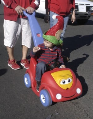 Oro Valley Holiday Parade: Sabastian Solomon, 2, gets a ride during the festivities.  - Don Boorse/Special to the Explor