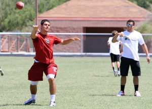 Dorado Camp Of Champions: Blake Martinez, left, and Jared Tevis, right, who are both former Canyon Del Oro High School football players run a scrimmage during the school's summer football camp for sixth, seventh and eighth graders last week.  - Randy Metcalf/The Explorer