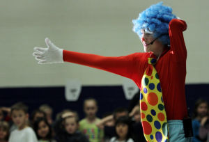 Clown College: Henry Goldsmith gets the younger students at his school warmed up for the performance by showing off his dance moves. Earlier this month, students at Wilson K-8 put on a circus show as part of its clown college portion of class. - Randy Metcalf/The Explorer