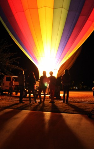 Marana Holiday Tree Lighting: Spectators gather as a tethered hot air balloon ignites its burner, during the balloon glow portion of Marana's holiday festivities Friday.  - Randy Metcalf/The Explorer