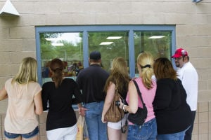 First Day Of School At Twin Peak Elementary School: Parents gather at the window of their child's kindergarten classroom after dropping them off for their first day of school at Twin Peaks Elementary School Monday. - Randy Metcalf/The Explorer