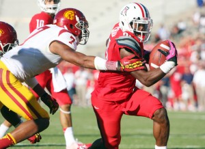 UofA Vs USC Football: Ka'Deem Carey makes his way past T.J. McDonald to run the ball in for a touchdown.  - Randy Metcalf/The Explorer