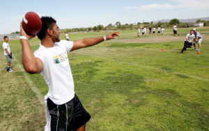 Dorado Camp Of Champions: CDO gradate Isaac Chacon throws a pass to a camper during the annual Dorado Camp of Champions last week.  - Randy Metcalf/The Explorer