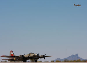 Wings Of Freedom Tour: The B17 makes its way across the runways at Marana's airport as a personal airplane flies by.  - Randy Metcalf/The Explorer