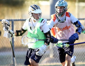 Oro Valley Lacrosse Club: Chris Gin, left, keeps the ball away from Cole Frost during a lacrosse scrimmage at James Krieg Park last week.  - Randy Metcalf/The Explorer
