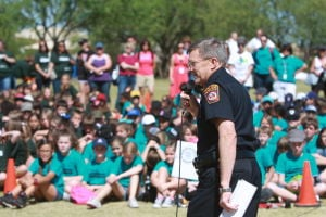 Drug Awareness Day: Oro Valley Police Chief Danny Sharp speaks to a crowd of fifth-grade students at the start of Drug Awareness Day last week.  - Randy Metcalf/The Explorer