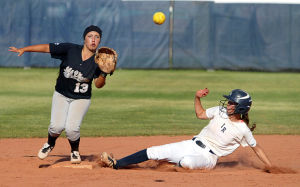 Ironwood Ridge Vs Mountain View Softball: Ironwood Ridge High School's Loriann Olson slides safely into second base and Mountain View High School's Ashley Rivera catches the throw. The Nighthawks won 15-0.  - Randy Metcalf/The Explorer
