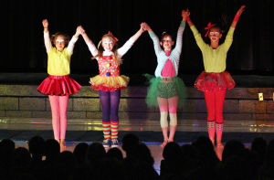 Clown College: Victoria Hermann, Mia Marrero-Welch, Olivia Hamer and MacKenzie Sutliff take a bow after their performance. Earlier this month, students at Wilson K-8 put on a circus show as part of its clown college portion of class. - Randy Metcalf/The Explorer