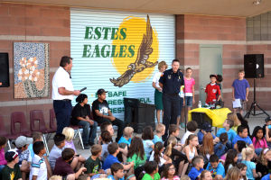 Being A Good Citizen: During a ceremony at Estes Elementary School, two students were recognized for coming to the aid of a stranger in need.  - Randy Metcalf/The Explorer