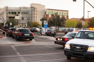 U Of A Gun Threat: Tucson Police Department vehicles at the University of Arizona where a man was seen walking in the Administration building with a rifle.  - J.D. Fitzgerald/The Explorer