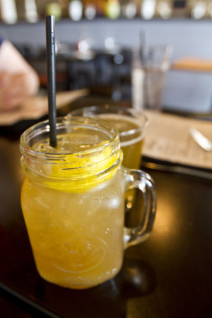 Sippin' Social - Jax Kitchen: Jax Kitchen's The Little Piggy is an apple-infused whiskey drink mixed with honey simple syrup and fresh lemon. - Randy Metcalf/The Explorer