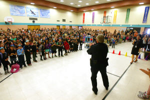 Oro Valley Police Officer Ed Holdinsky: Oro Valley Police Officer Ed Holdinsky was called into the Copper Creek Elementary School gymnasium by the entire student body chanting his name. - Randy Metcalf/The Explorer