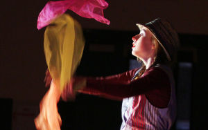 Clown College: Emily Pickard takes her moment in the spotlight to juggle scarfs. Earlier this month, students at Wilson K-8 put on a circus show as part of its clown college portion of class. - Randy Metcalf/The Explorer