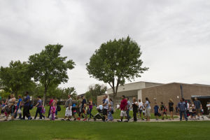 First Day Of School At Twin Peak Elementary School: Parents walk their kids to their classrooms on the first day of school Monday at Twin Peaks Elementary School. - Randy Metcalf/The Explorer