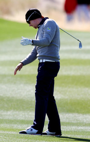 Accenture Match Play Championship: Defending champion Hunter Mahan loses his club after hitting a shot that sent his ball to the right of the 13th green during the final round of the Accenture Match Play Championship.  - Randy Metcalf/The Explorer
