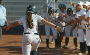 Ironwood Ridge Vs Mountain View Softball: Nighthawks' Lexi Adelberg spreads out her arms as she comes into home plate after hitting a homerun during last week's game against the Mountain Lions.  - Randy Metcalf/The Explorer
