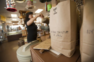 The Wild Bird Store: Clarissa Friedman mixes a custom concoction of bird feed, called Nyjer Thistle, which is designed to attract goldfinches. - Randy Metcalf/The Explorer