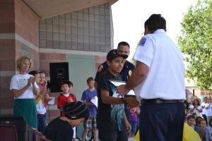 Being A Good Citizen: Estes Elementary School sixth-grader Julian Rodriguez is given an award for being a good citizen.  - Randy Metcalf/The Explorer
