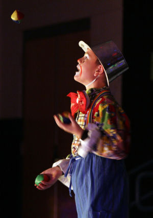Clown College: Liam Jorgenson shows off his ability to juggle balls. Earlier this month, students at Wilson K-8 put on a circus show as part of its clown college portion of class. - Randy Metcalf/The Explorer