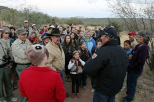 Desert Bighorn Sheep Release: Officials brief the people before the release of the desert bighorn sheep on where they will be allowed to stand. - Randy Metcalf/The Explorer