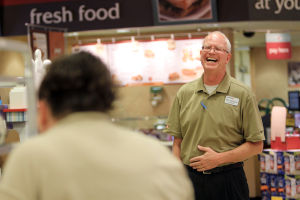 Safeway's Mike Hennings: Safeway Store Manager Mike Hennings has a laugh with coworker and baker Tracy Marsac last week. After 42 years with the company and with much resistance from his coworkers and people in the community, Hennings is retiring. His last day will be this Saturday.  - Randy Metcalf/The Explorer