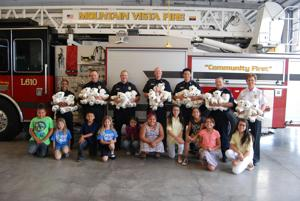Local youth pay it forward by donating bears to MVFD