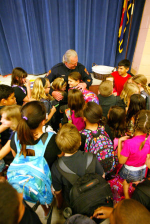 Oro Valley Police Officer Ed Holdinsky: After Oro Valley Police Officer Ed Holdinsky's retirement celebration at Copper Creek Elementary School, he was mobbed by dozens of students for hugs. - Randy Metcalf/The Explorer