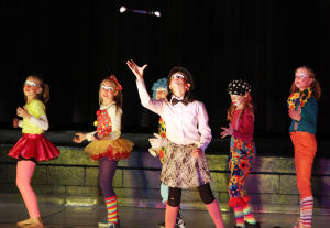 Clown College: Kayla Corcoran stands front and center while showing off her baton twirling skills. Earlier this month, students at Wilson K-8 put on a circus show as part of its clown college portion of class. - Randy Metcalf/The Explorer