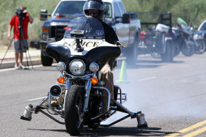 Motorcycle Accident Class: Oro Valley police officer Brian Kleinberg locks up his rear brake at about 40 mph. - Randy Metcalf/The Explorer