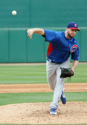 Spring Training: Cubs' pitcher Scott Feldman sends a pitch towards home plate.  - Randy Metcalf/The Explorer