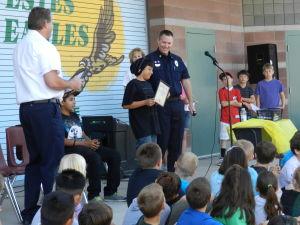 Being A Good Citizen: Estes Elementary School sixth-grader William ÒBlueboyÓ Estrella is given an award for being a good citizen.  - Randy Metcalf/The Explorer