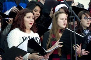 Marana Christmas: Makayla Schall (left), Rebekah Butler (middle) and Rebecca Porter (right) sing with Voices Unlimited. - Hannah McLeod/The Explorer