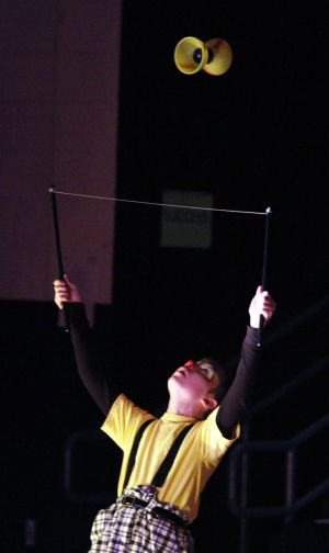 Clown College: Using two rods, a string and an hourglass shaped object, Jalen Potter puts on a short performance. Earlier this month, students at Wilson K-8 put on a circus show as part of its clown college portion of class. - Randy Metcalf/The Explorer