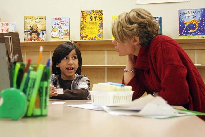 Volunteers teach reading, 1-on-1