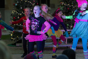 "Marana Christmas: Katie Enneper performs with the eight to 15-year-old dance group from Tucson Dance Academy in ""The Grinch"" dance. - Hannah McLeod/The Explorer"