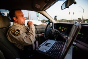 HIOP: Pima County Sheriff Deputy Jamie McNeely communicates with dispatch on his way out to investigate houses associated with drug activity.  - J.D. Fitzgerald/The Explorer