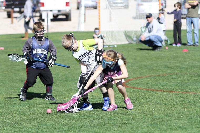 Oro Valley Lacrosse Club 8U - hotly contested.jpg