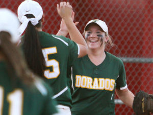 Canyon Del Oro Vs Salpointe Softball: Third baseman Heather Knight high-fives pitcher Alexis Alfonso after a third out.  - Randy Metcalf/The Explorer