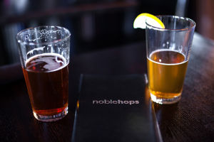 Noble Hops: Two of Noble Hops' draft beers, the Rubicon Irish Red and Sleepy Dog Leg Humper.  - J.D. Fitzgerald/The Explorer