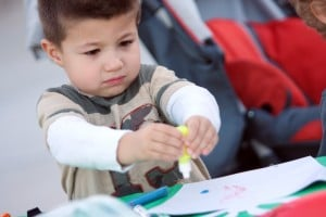 Marana Holiday Tree Lighting: Michael Southard, 5, squeezes out some paint at the arts and crafts table in Marana.  - Randy Metcalf/The Explorer