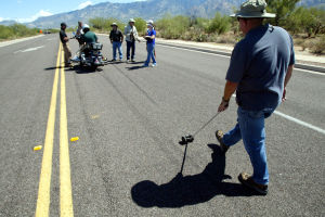 Motorcycle Accident Class: Pima County Sheriff's Department traffic deputy Ryan Roher measures the length of a skid mark during a motorcycle accident reconstruction class in Oro Valley. - Randy Metcalf/The Explorer