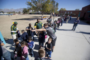 Canyon Del Oro Football Team's Hoodie Drive: Each student at Prince Elementary School was given a hoodie, as part of the Dorado's annual hoodie drive. - Randy Metcalf/The Explorer