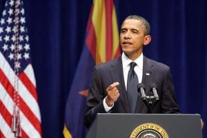Obama: Randy Metcalf/The Explorer, President Barack Obama addresses the crowd at McKale Center last Wednesday night in the wake of the mass shooting on Jan. 8.