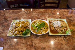 Grain River Asian Bistro: Grain River Asian Bistro serves Orange Chicken, Red Curry and a Pad Thai dish at its restaurant. - Hannah McLeod/The Explorer