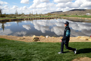 Accenture Match Play Championship: Rickie Fowler walks past the lake between the third and fourth hole Thursday.  - Randy Metcalf/The Explorer