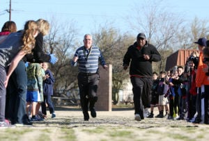 Olympic Medalist Michael Bates: After running through drills and exercises, Michael Bates was challenged to a sprint race by Mesa Verde Elementary School Principal Foster Hepler.  - Randy Metcalf/The Explorer