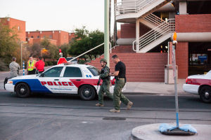 U Of A Gun Threat: Tucson Police Department, and University of Arizona Police vehicles at the University of Arizona where a man was seen walking in the Administration building with a rifle.  - J.D. Fitzgerald/The Explorer